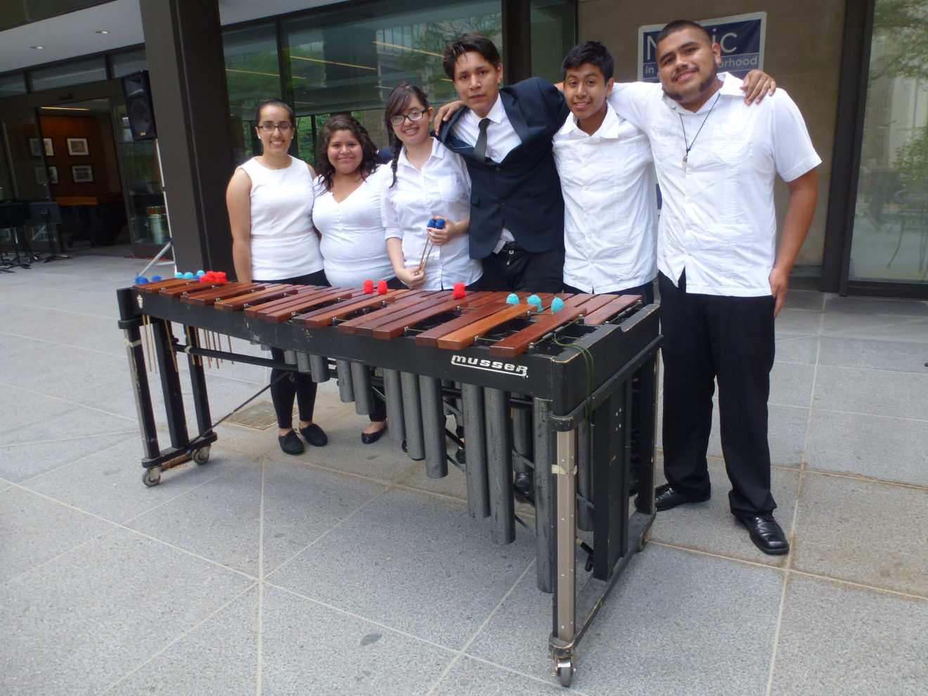 Marimba Performers enjoying the outdoor and getting ready for their concert.